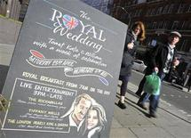 <p>A sign stands outside a pub promoting Royal Wedding events, in central London April 4, 2011. REUTERS/Toby Melville</p>