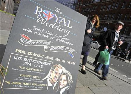 A sign stands outside a pub promoting Royal Wedding events, in central London April 4, 2011. REUTERS/Toby Melville