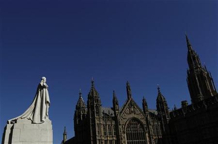 A statue of King George V overlooks the Houses of Parliament in London April 8, 2011. REUTERS/Luke MacGregor