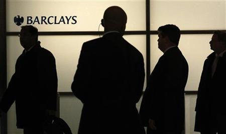 People walk through the lobby of Barclays bank at Canary Wharf in London April 5, 2011. REUTERS/Suzanne Plunkett