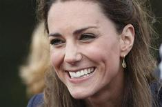 <p>Kate Middleton, fiancee of Britain's Prince William, reacts to the crowd during a visit Witton Country Park in Darwen, northern England April 11, 2011. REUTERS/Alastair Grant/Pool</p>
