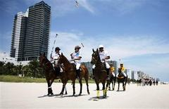 <p>(L-R) AMG-Mercedes polo players Michael Liss, Nacho Figueras and Pelon Escapite ride along Miami Beach en route to their first round match in this 2010 handout image. REUTERS/Mitchell Zachs-The Polo Life/Handout</p>
