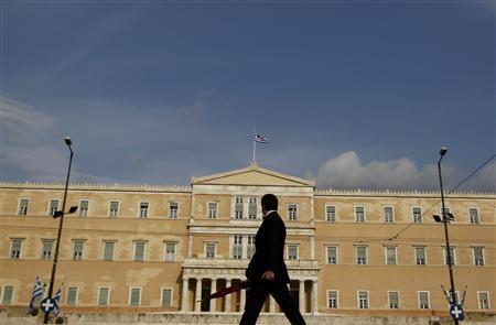 A man walks in front of the parliament in Athens April 20, 2011. REUTERS/Yiorgos Karahalis