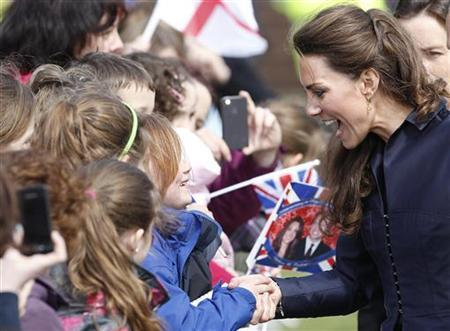 Kate Middleton, the fiancee of Prince William talks to children during their visit to Witton Country Park in Darwen, northern England April 11, 2011. REUTERS/Darren Staples
