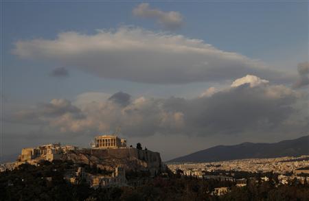 Clouds are seen over Acropolis hill in Athens, April 20, 2011. REUTERS/John Kolesidis