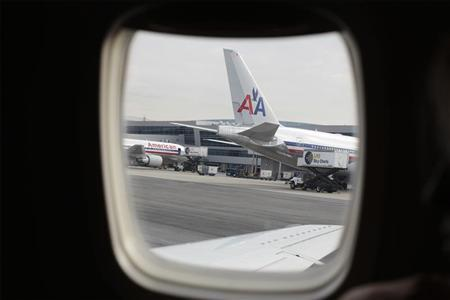 American Airlines planes can be seen through a plane window at John F Kennedy International Airport in New York December 28, 2009. REUTERS/Lucas Jackson