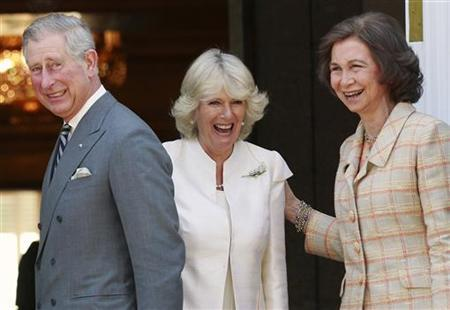 Prince Charles, his wife Camilla (C), Duchess of Cornwall, and Spain's Queen Sofia (R) share a laugh before a private lunch at Zarzuela palace in Madrid March 31, 2011. REUTERS/Andrea Comas