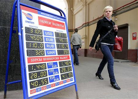 A woman passes by a currency exchange office in Minsk, April 15, 2011. REUTERS/Vasily Fedosenko