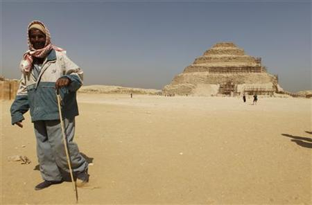 A guide stands near the Djoser's step pyramid in Saqqara, outside of Cairo March 5, 2011. REUTERS/Peter Andrews