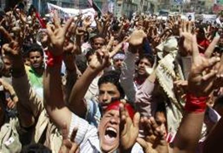 Protesters shout slogans during a demonstration demanding the ouster of Yemen's President Ali Abdullah Saleh in the southern Yemeni city of Taiz April 21, 2011.REUTERS/Khaled Abdullah