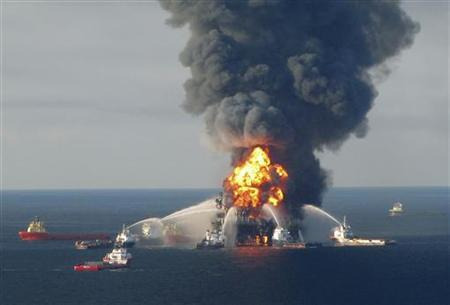 Fire boat response crews battle the blazing remnants of the off shore oil rig Deepwater Horizon, off Louisiana, in this handout photograph taken on April 21, 2010 and obtained on April 22. REUTERS/U.S. Coast Guard/Handout