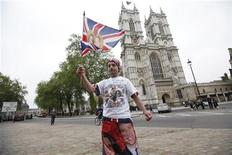 <p>Royalty fan John Loughrey poses for journalists outside Westminster Abbey ahead of this week's Royal wedding, in central London, April 26, 2011.REUTERS/Andrew Winning</p>