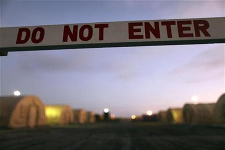 In this photo, reviewed by the U.S. Military, a sign marks a closed-off area, at Camp Justice, the location of the U.S. Military Commissions court for war crimes, at the U.S. Naval Base, in Guantanamo Bay, Cuba, January 19, 2009. REUTERS/Brennan Linsley/Pool
