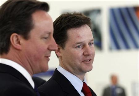 Prime Minister David Cameron (L) and Deputy Prime Minister Nick Clegg tour the Rolls Royce engine production facility, in Derby, March 7, 2011. REUTERS/Christopher Furlong/Pool