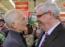 <p>Canada's NDP leader Jack Layton speaks with Manitoba Premier Greg Selinger at a campaign rally in Winnipeg, Manitoba April 27, 2011. REUTERS/Fred Greenslade</p>
