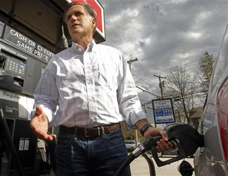 Former Massachusetts Governor and likely Republican Presidential candidate Mitt Romney pumps gas into a staff member's vehicle during a stop at Hillsborough Gas and Repair in Manchester, New Hampshire April 29, 2011. REUTERS/Brian Snyder