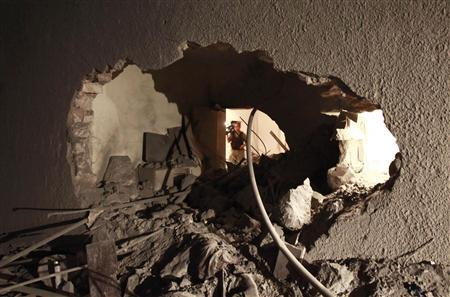 EDITOR'S NOTE: PICTURE TAKEN ON GUIDED GOVERNMENT TOUR Damage which the Libyan government said was caused by a coalition air strike is seen at the house of Saif Al-Arab Gaddafi, son of Libyan leader Muammar Gaddafi, in Tripoli April 30, 2011. REUTERS/Louafi Larbi