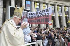 <p>Pope Benedict XVI kisses a baby as he arrives to celebrate a mass for the beatification of Pope John Paul II in Saint Peter's Square at the Vatican May 1, 2011. REUTERS/Osservatore Romano</p>
