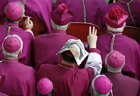 Bishops wait before the mass for the beatification of Pope John Paul II in St. Peter's square at the Vatican May 1, 2011. REUTERS/Stefano Rellandini