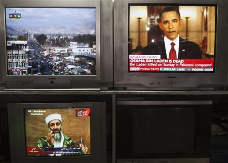 News telecasts on television sets at a store in Kabul, May 2, 2011. REUTERS/Ahmad Masood