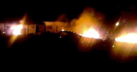 The compound, within which al Qaeda leader Osama bin Laden was killed, is seen in flames after it was attacked in Abbottabad in this still image taken from video footage from a mobile phone May 2, 2011. REUTERS/Stringer