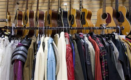 A rack with some of music's most iconic clothing waits to leave the Hard Rock's Rock Vault in Orlando, Florida April 21, 2011, as part of the Hard Rock's 40th Anniversary Memorabilia Tour. REUTERS/Scott Audette