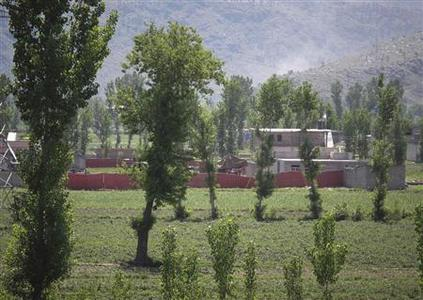 Surrounded in red fabric, a compound is seen where locals reported a firefight took place overnight in Abbotabad, located in Pakistan's Khyber Pakhtunkhwa province, May 2, 2011. REUTERS/Abrar Tanoli