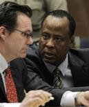 <p>Doctor Conrad Murray (R), the late Michael Jackson's personal physician, confers with his lawyer Edward Chernoff during his arraignment on a charge of involuntary manslaughter in the pop star's death, in Los Angeles, California, January 25, 2011. REUTERS/Pool/Irfan Khan</p>