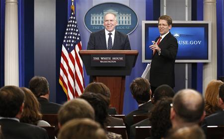 John Brennan (L), assistant to the president for homeland security and counterterrorism, and White House Press Secretary Jay Carney smile as they take the rostrum to speak about the killing of Osama bin Laden from the Briefing Room of the White House in Washington May 2, 2011. REUTERS/Kevin Lamarque