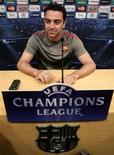 <p>Xavi Hernández em coletiva de imprensa no estádio de Camp Nou, em Barcelona. 02/05/2011 REUTERS/Albert Gea</p>