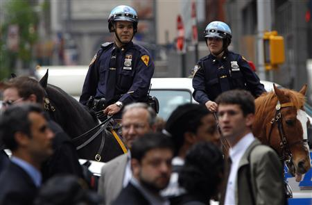 New York City mounted police look over pedestrians in New York's Times Square as police investigated a suspicious package on 43rd street May 2, 2011. REUTERS/Mike Segar