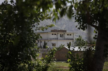 The compound where al Qaeda leader Osama bin Laden was killed in Abbottabad is seen framed by nearby trees May 3, 2011. REUTERS/Akhtar Soomro