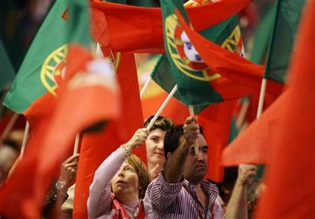 Portuguese wave flags during a Socialist Party Congress in Matosinhos, near Porto April 10, 2011. REUTERS/Miguel Vidal