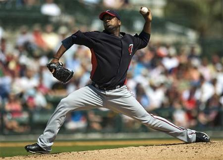 Minnesota Twins starter Francisco Liriano pitches against the Baltimore Orioles during the second inning of a spring training baseball game at Ed Smith Stadium in Sarasota, Florida, March 9, 2011 REUTERS/Steve Nesius