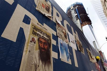 Newspapers fronts are seen on a fence at the World Trade Center site in New York, May 3, 2011 after U.S. forces killed Osama Bin Laden in Pakistan early Monday. REUTERS/Shannon Stapleton