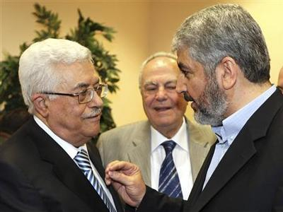 Hamas leader Khaled Meshaal speaks with President Mahmoud Abbas during their meeting in Cairo, May 4, 2011. REUTERS/Hamas