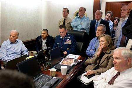 President Barack Obama (2nd L) and Vice President Joe Biden (L), along with members of the national security team, receive an update on the mission against Osama bin Laden in the Situation Room of the White House, May 1, 2011. Also pictured are Secretary of State Hillary Clinton (2nd R) and Defense Secretary Robert Gates (R). Please note: A classified document seen in this photograph has been obscured at source. Picture taken May 1, 2011. REUTERS/White House/Pete Souza/Handout