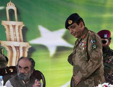Pakistani Army Chief Ashfaq Parvez Kayani (R) attends an inaugural ceremony of a technical training center in Gwadar, Balochistan Province April 18, 2011. REUTERS/Faisal Mahmood