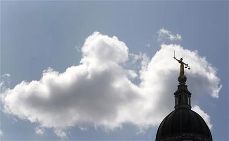 The Lady of Justice is seen on top of the ''Old Bailey'' Central Criminal Court, in Central London July 10, 2009. REUTERS/Stephen Hird