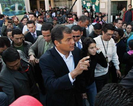 Ecuador's President Rafael Correa (C), joined by his daughter Sofia, addresses the media as they cast their votes in Quito May 7, 2011. REUTERS/Kevin Granja