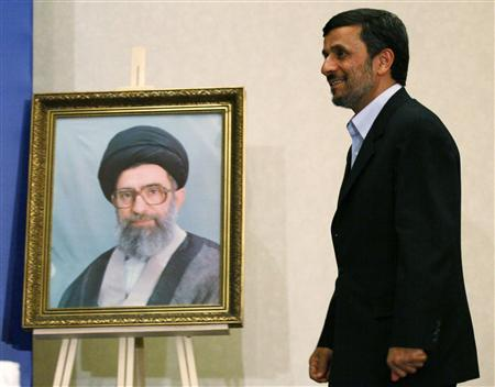Iran's President Mahmoud Ahmadinejad walks past a portrait of Iran's Supreme Leader Ayatollah Ali Khamenei as he arrives at a news conference in Istanbul May 9, 2011. REUTERS/Murad Sezer