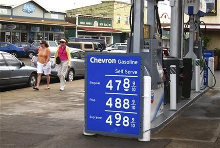 A signboard displays the price of gas in the town of Paia, in Maui, Hawaii April 8, 2011. REUTERS/Mike Blake