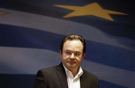 Greece's Finance Minister George Papaconstantinou listens to reporters' questions inside a ministry hall in Athens, May 7, 2011. REUTERS/Yiorgos Karahalis