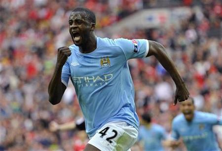 Manchester City's Yaya Toure celebrates after scoring during their FA Cup semi-final soccer against Manchester United at Wembley Stadium in London in this April 16, 2011 file photo. REUTERS/Toby Melville