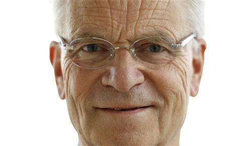British author Jeffrey Archer poses for a photograph in his flat in London May 5, 2011. REUTERS/Suzanne Plunkett