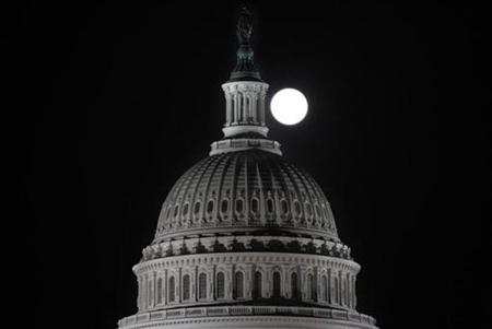 The full moon rises behind the Capitol Dome in Washington March 19, 2011. REUTERS/Hyungwon Kang