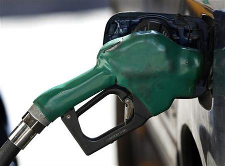 A gas nozzle is used to pump gasoline at a station in New York February 22, 2011. REUTERS/Shannon Stapleton