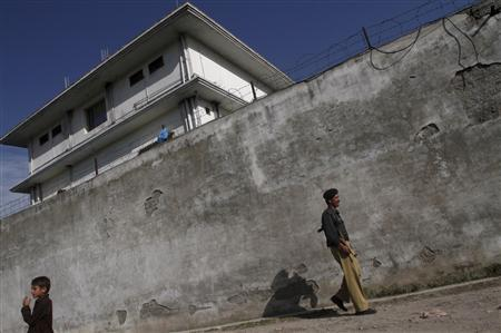 A policeman walks in front of the compound where al Qaeda leader Osama bin Laden was killed in Abbottabad May 3, 2011. REUTERS/Faisal Mahmood