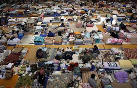 Tsunami victims rest after observing a minute of silence at 14:46 local time at a shelter in Watari, Miyagi prefecture, April 22, 2011. REUTERS/Toru Hanai