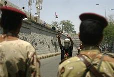 <p>An anti-government protester shouts at army soldiers at a barrier blocking a demonstration calling for the ouster of Yemen's President Ali Abdullah Saleh in the southern city of Taiz May 12, 2011. REUTERS/Khaled Abdullah</p>